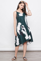 RURI PRINTED DROPWAIST DIP HEM DRESS IN GREEN